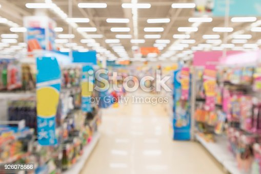 istock Abstract blur supermarket discount store aisle and product shelves interior defocused background 926078666