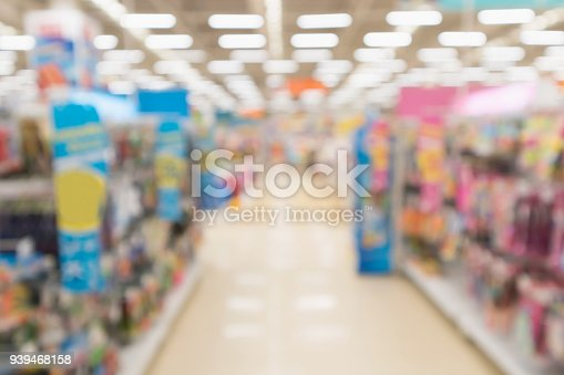 926078666 istock photo Abstract blur supermarket discount store aisle and product shelves interior defocused background 939468158