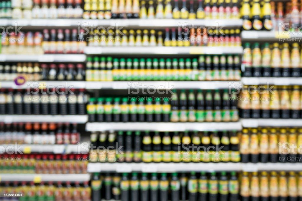 Abstract blur supermarket shelves with various seasoning sauce...