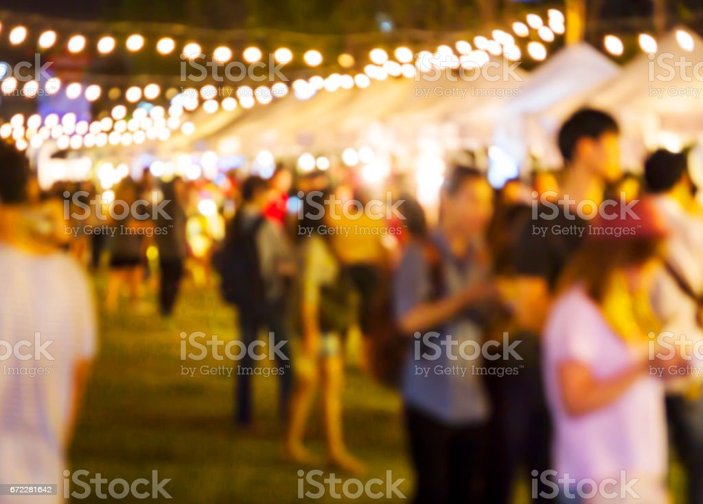 Abstract blurred background of people shopping at night market stock photo