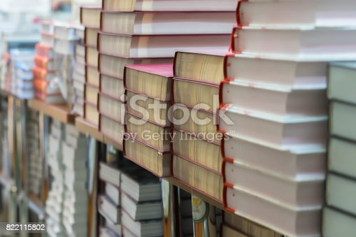 istock Abstract blurred background of pile of books, textbooks, fiction in book store or in library. Education, school, study, reading fiction concept 822115802