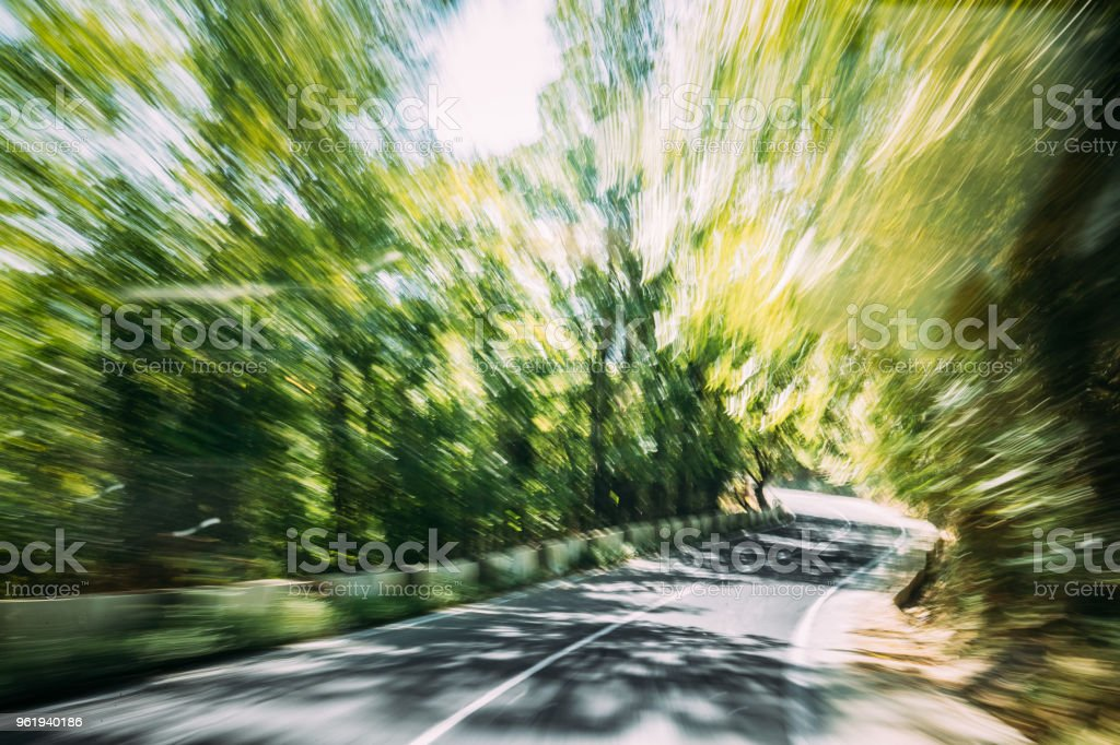 Abstract Blurred Background Of Road In Fast Motion. Summer Cloudy Sky Above Asphalt Motorway, Highway, Freeway In Europe. Travel And Transportation Background stock photo