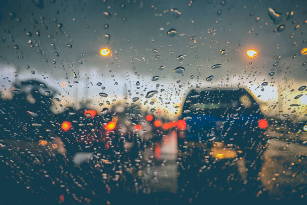 Abstract blurred background of traffic jam on heavy rain stock photo