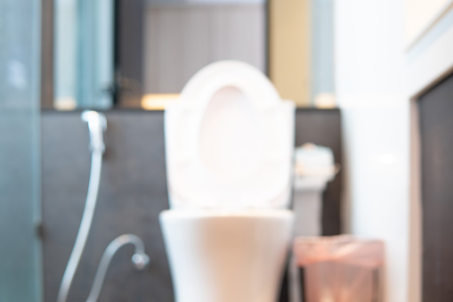 800987054 istock photo Abstract blurred bathroom interior Background. Empty white marble tile for product display with window bokeh focus concept for hotel spa. luxury interior home restroom 1197042992