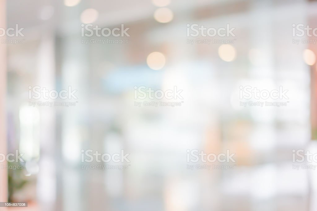 abstract blurred beautiful interior of lobby reception condominium background with bokeh light from lamp ,for presentation , banner design royalty-free stock photo