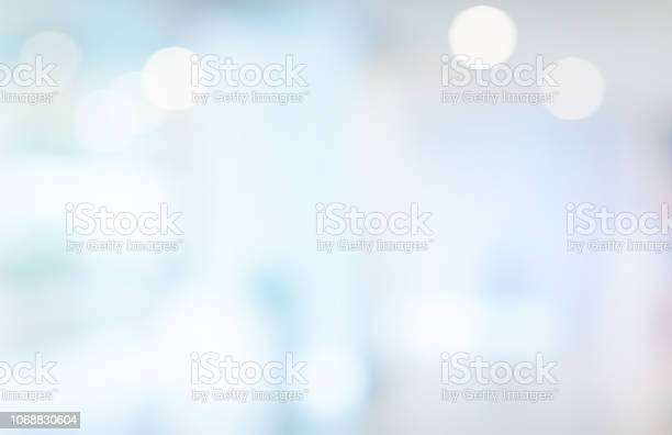 Photo of abstract blurred beautiful interior of lobby reception condominium background with bokeh light from lamp ,for presentation , banner design