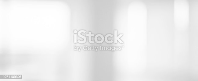 istock abstract blurred beautiful interior workplace meeting room with window light background ,for presentation , banner design 1071109306
