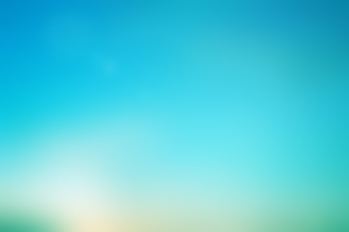 abstract blurred beauty teal color with flash aura and sparkle ray lens flare light effect for beauty background concept.vintage tone