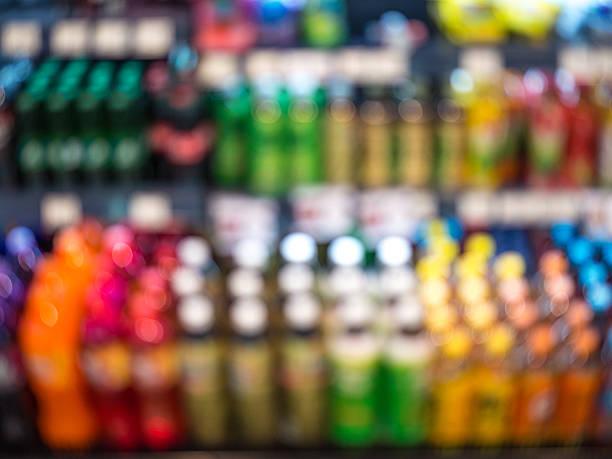 abstract blurred beverage product and sparkling water - teeladen stock-fotos und bilder