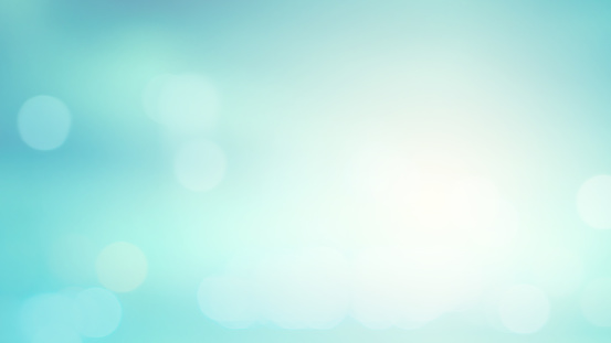 abstract blurred blue an teal color gradient background with shiny glowing light effect and bokeh for summer collection design element concept