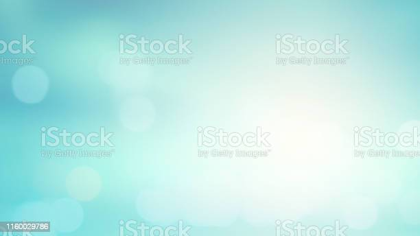 Photo of abstract blurred blue an teal color gradient background with shiny glowing light effect and bokeh for summer collection design element concept
