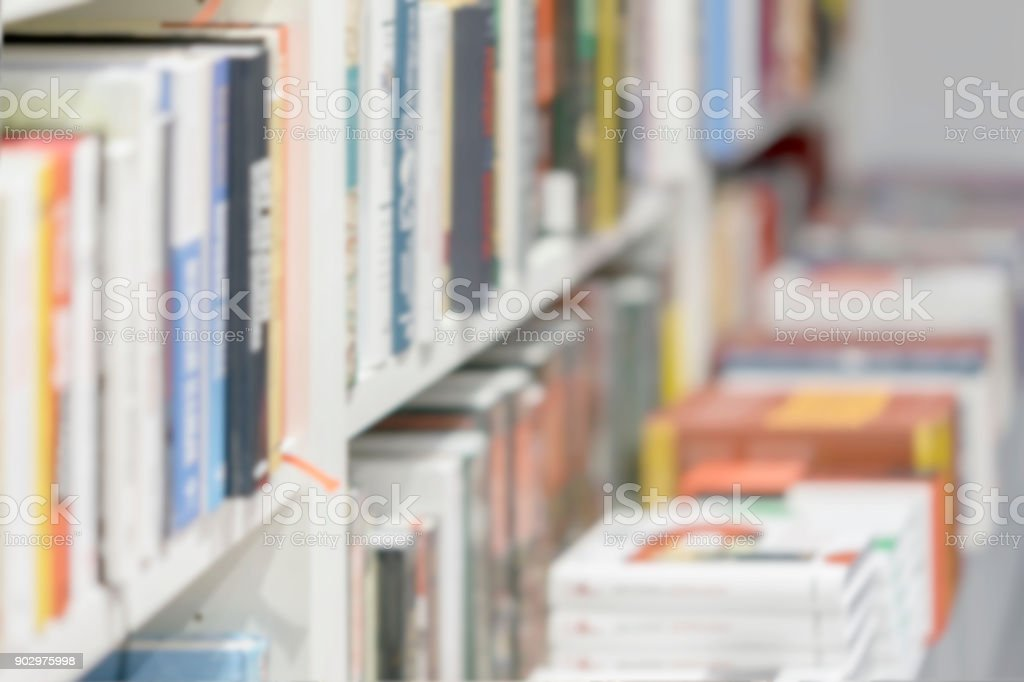 Abstract blurred books, manuals and textbooks, bookshelves with books, library or book store, for light backdrop. Concept for education stock photo