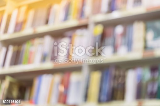 istock Abstract blurred books, manuals and textbooks on bookshelves in library or in book store, for backdrop. Concept for education 822116104