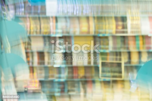 istock Abstract blurred books, manuals and textbooks on bookshelves in library or in book store, for background. Education concept, reading fiction, life style 846545490