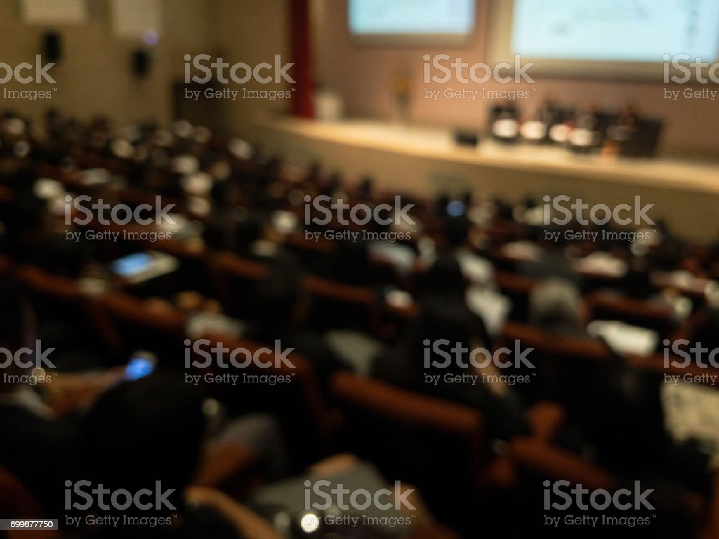 Abstract blurred businessman lecture in seminar room stock photo
