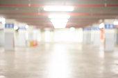 Abstract blurred cars park or parking lot. Defocused background or backdrop for transportation concept