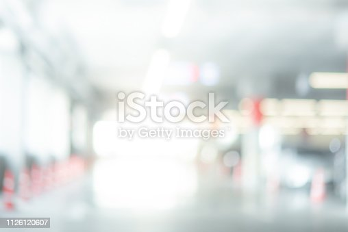 683425144 istock photo Abstract blurred cars parked in parking lot of shopping mall. Defocused background or backdrop for industrial and transportation concepts 1126120607