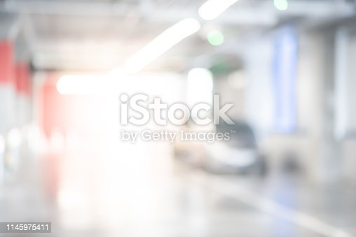 683425144 istock photo Abstract blurred cars parked in parking lot of shopping mall. Defocused background or backdrop for industrial and transportation concepts 1145975411
