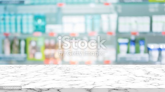 istock abstract blurred clean pharmacy drug store shelf with medicine for shopping with white marble texture plain for ads,promote product on display 1059959984