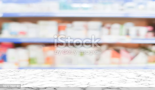 836113142 istock photo abstract blurred clean pharmacy drug store shelf with medicine for shopping with white marble texture plain for ads,promote product on display 1077769192