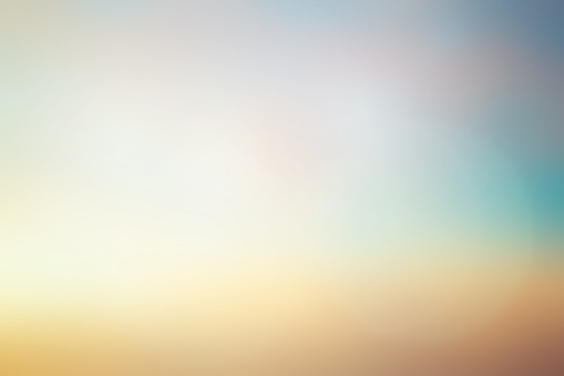 abstract blurred early sunlight of teal and gold color sky background with lens flare light for design element as banner , presentation
