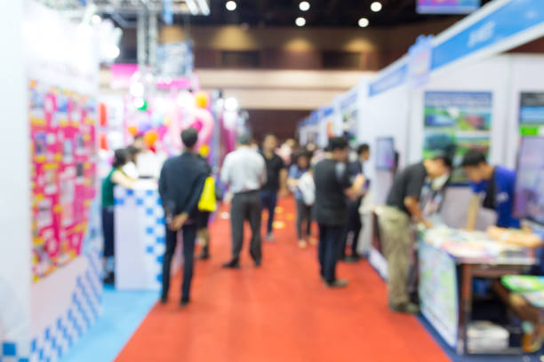 Abstract blurred event exhibition with people background, business convention show concept stock photo
