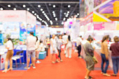 istock Abstract blurred event exhibition with people background, business convention show concept 1059441412