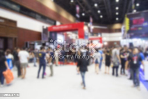 istock Abstract blurred event with people for background 658024714