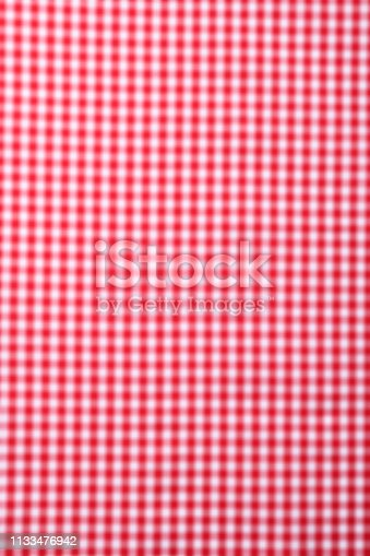 Close-up of abstract blurred gingham check fabric texture background.