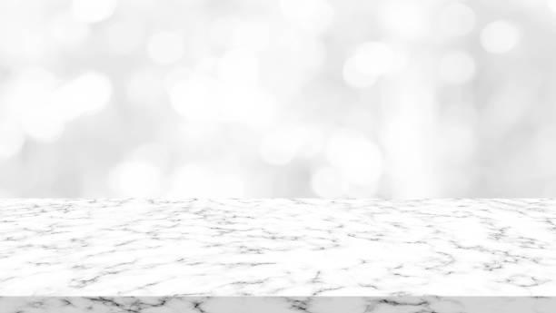 leuchtende farbe grau gradient hintergrundunschärfe mit marmor-arbeitsplatte perspektive für werbung zu abstrahieren, fördern auf bild - tresentisch stock-fotos und bilder