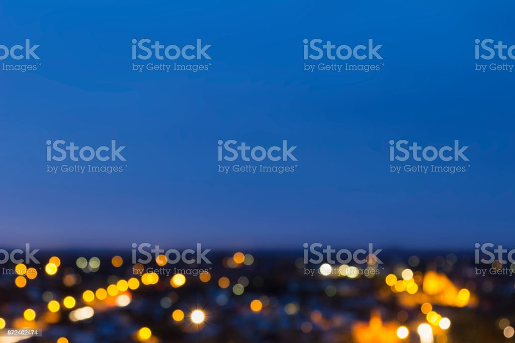Abstract blurred image of outback Australian country town. City light bokeh with a defocused blue sky background. stock photo
