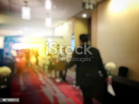 478810450 istock photo Abstract blurred image of people sitting in conference room for profession seminar with attendee, presenter and audience background, business & educaction concept, official new product launches 867995010