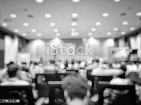 478810450 istock photo Abstract blurred image of people sitting in conference room for profession seminar with attendee, presenter and audience background, business & educaction concept, official new product launches 873776618