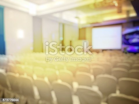 873776668 istock photo Abstract blurred image of people sitting in conference room for profession seminar with attendee, presenter and audience background, business & educaction concept, official new product launches 873776644