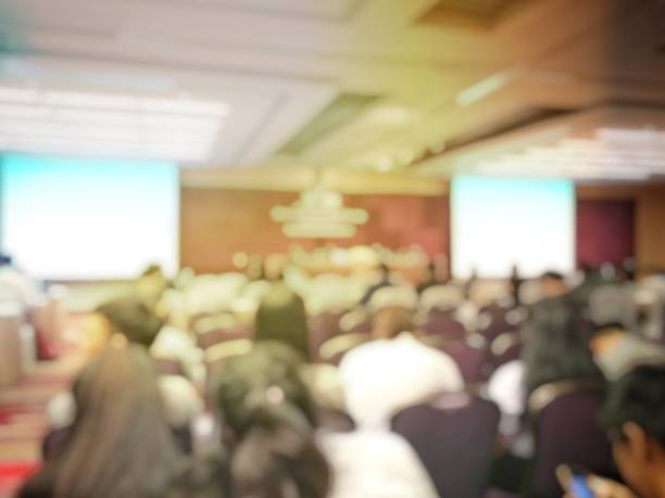abstract blurred image of people sitting in conference room for profession seminar with attendee, presenter and audience background, business & educaction concept, official new product launches - large stock pictures, royalty-free photos & images