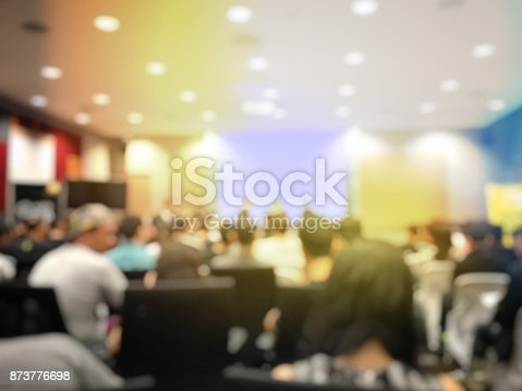 873776668 istock photo Abstract blurred image of people sitting in conference room for profession seminar with attendee, presenter and audience background, business & educaction concept, official new product launches 873776698