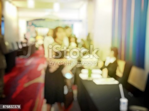478810450 istock photo Abstract blurred image of people sitting in conference room for profession seminar with attendee, presenter and audience background, business & educaction concept, official new product launches 876832378