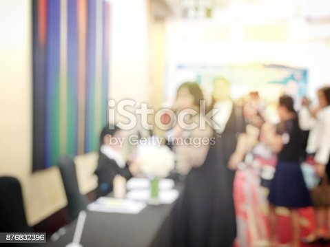 478810450 istock photo Abstract blurred image of people sitting in conference room for profession seminar with attendee, presenter and audience background, business & educaction concept, official new product launches 876832396