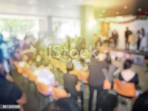 478810450 istock photo Abstract blurred image of people sitting in conference room for profession seminar with attendee, presenter and audience background, business & educaction concept, official new product launches 881355586