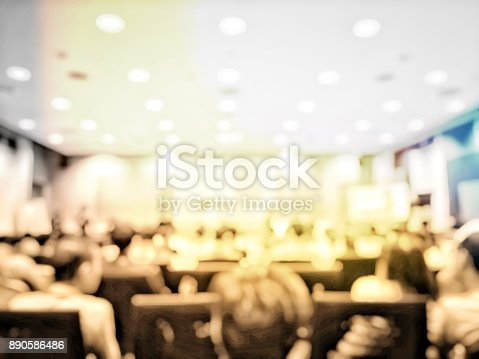 478810450 istock photo Abstract blurred image of people sitting in conference room for profession seminar with attendee, presenter and audience background, business & educaction concept, official new product launches 890586486