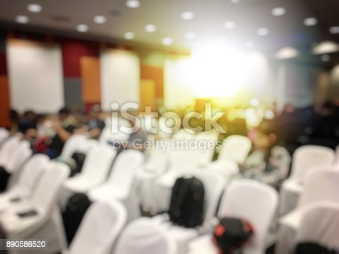 istock Abstract blurred image of people sitting in conference room for profession seminar with attendee, presenter and audience background, business & educaction concept, official new product launches 890586520