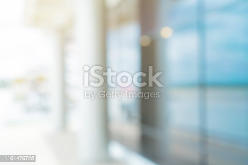 abstract blurred in front of entrance modern glass decorative of company hall background with morning light effect for design