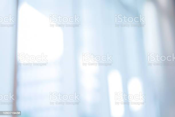Photo of abstract blurred in front of entrance workplace office background , blur modern glass window interior design concept