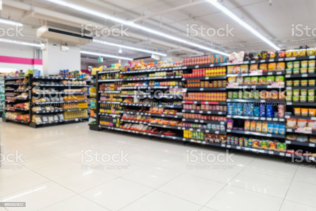 Abstract blurred in supermarket  and commodity product on shelf stock photo