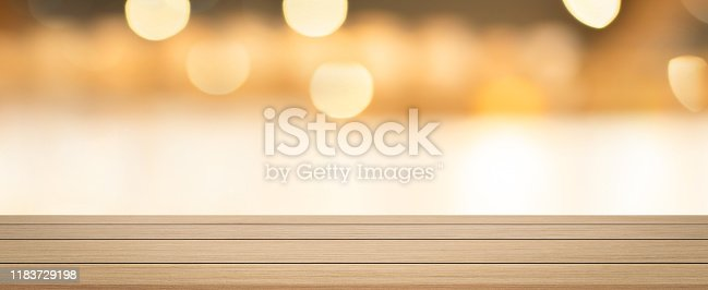 864907996istockphoto abstract blurred inside corridor interior of luxury restaurant bar background and modern wood counter table perspective background for show, promote, advertise product on display montage concept 1183729198