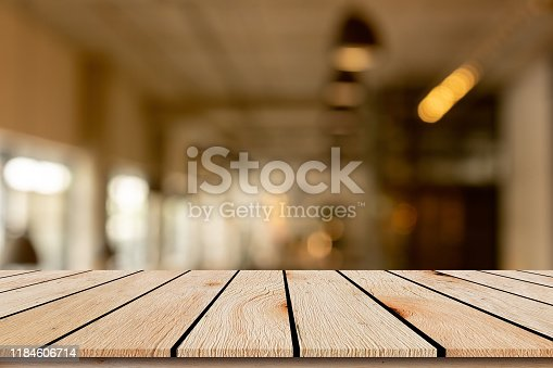 864907996istockphoto abstract blurred inside corridor interior of luxury restaurant bar background and modern wood counter table perspective background for show, promote, advertise product on display montage concept 1184606714