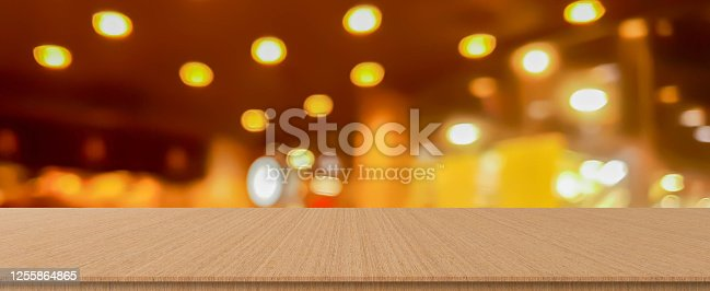 864907996 istock photo abstract blurred inside corridor interior of luxury restaurant bar background and modern wood counter table perspective background for show, promote, advertise product on display montage concept 1255864865