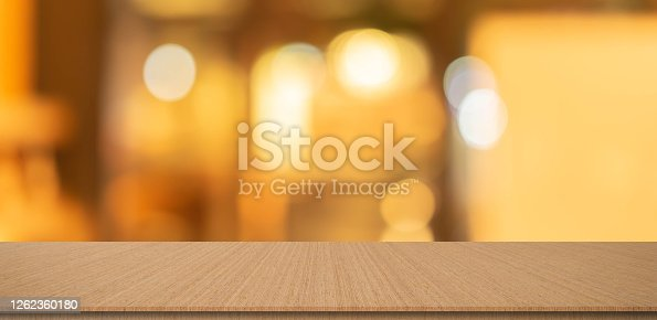 864907996 istock photo abstract blurred inside corridor interior of luxury restaurant bar background and modern wood counter table perspective background for show, promote, advertise product on display montage concept 1262360180