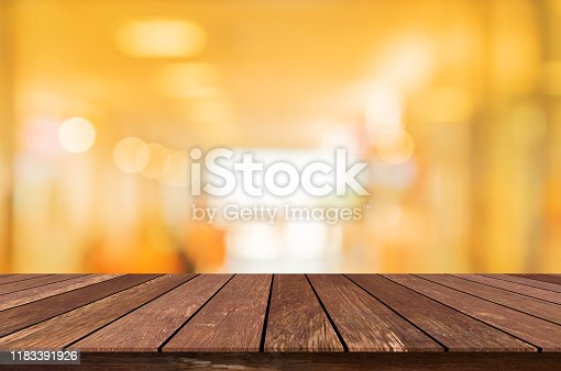 864907996istockphoto abstract blurred inside corridor interior of luxury restaurant background for design concept and vintage wood counter table perspective square background for show, promote, advertise product on display montage concept 1183391926