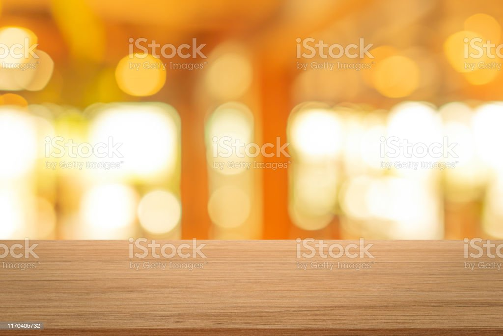 Abstract Blurred Inside Interior Of Luxury Restaurant With Light Bokeh Bulbs And Modern Wood Table Background For Adsshowpromote Product Design Concept Stock Photo Download Image Now Istock